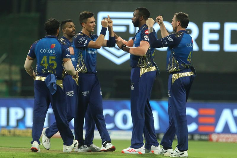 Mumbai Indians players celebrate the wicket of Shubman Gill of Kolkata Knight Riders.