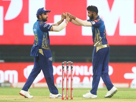Rohit Sharma and Jasprit Bumrah of Mumbai Indians celebrate the wicket of Eoin Morgan of Kolkata Knight Riders.
