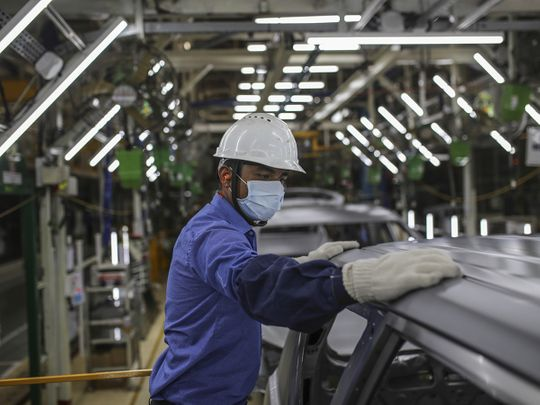 Stock India economy car factory