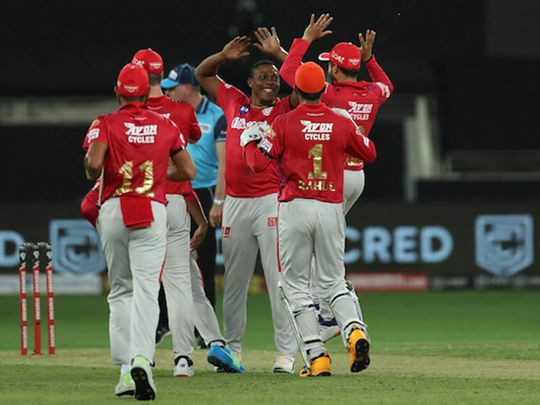 Sheldon Cottrell of Kings XI Punjab celebrates the wicket of Virat Kohli  during the Indian Premier League (IPL) match between Kings XI Punjab and Royal Challengers Bangalore
