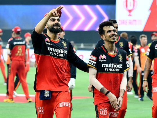 Virat Kohli and Yuzvendra Chahal celebrate Royal Challengers Bangalore's win over Sunrisers Hyderabad in Dubai.