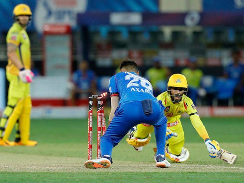 Axar Patel of Delhi Capitals inaction of running out Ruturaj Gaikwad of Chennai Superkings during match 7 of season 13, Dream 11 Indian Premier League (IPL) between Chennai Super Kings and Delhi Capitals held at the Dubai International Cricket Stadium