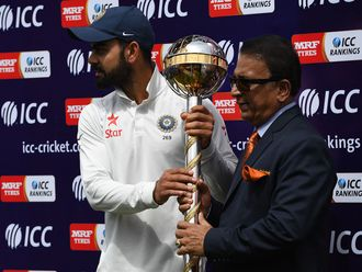 India and Royal Challengers Bangalore captain Virat Kohli with Sunil Gavaskar in 2017.