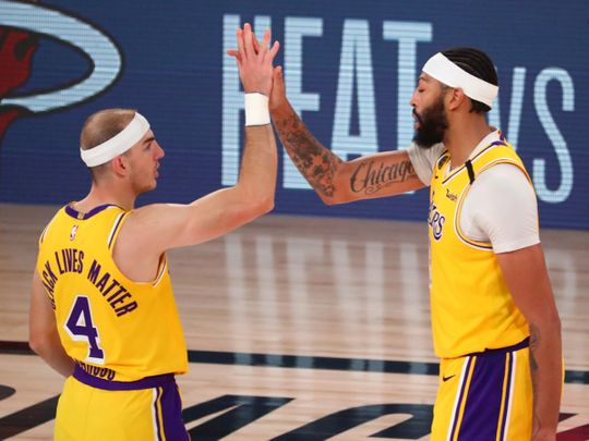 LA Lakers' Alex Caruso and Anthony Davis celebrate after defeating Denver Nuggets in Game 4