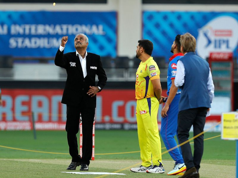 Match commissioner flipping the toss coin during match 7 of season 13, Dream 11 Indian Premier League (IPL) between Chennai Super Kings and Delhi Capitals held at the Dubai International Cricket Stadium, Dubai in the United Arab Emirates on the 25th September 2020. Photo by: Saikat Das / Sportzpics for BCCI