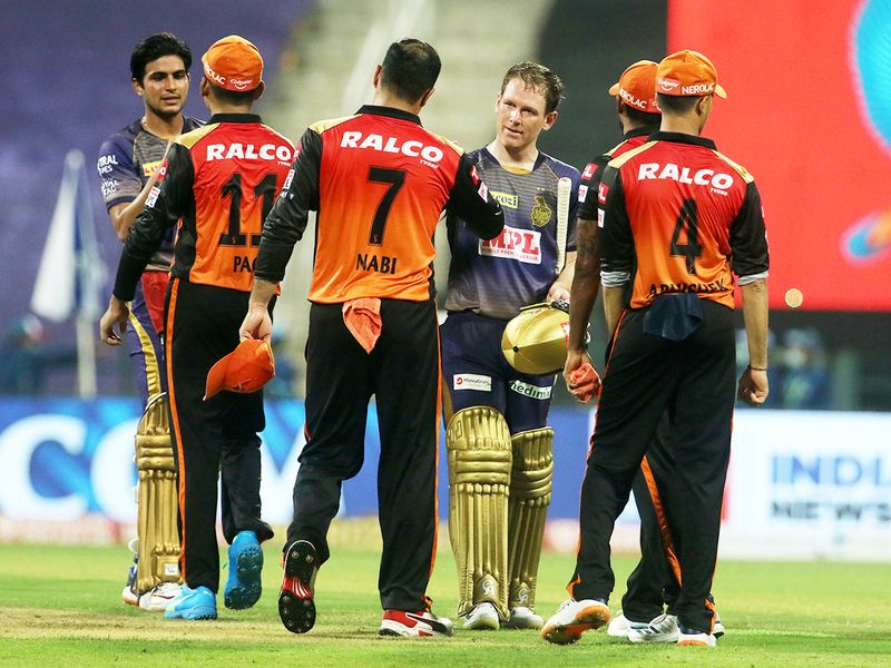 Players of Kolkata Knight Riders and Sunrisers Hyderabad greet each other