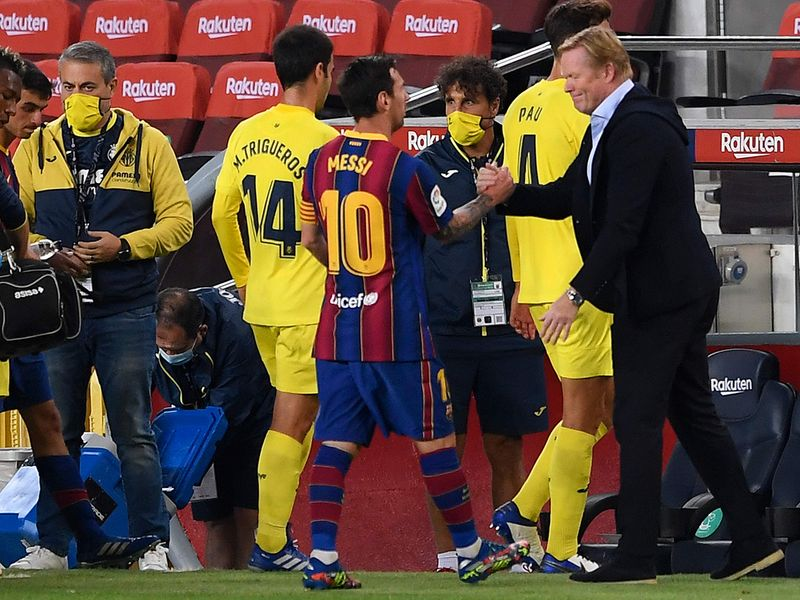 Lionel Messi with Barcelona coach Ronald Koeman