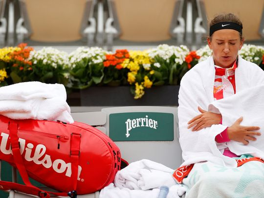 Victoria Azarenka shivers during her first-round match against Danka Kovinic at the French Open.