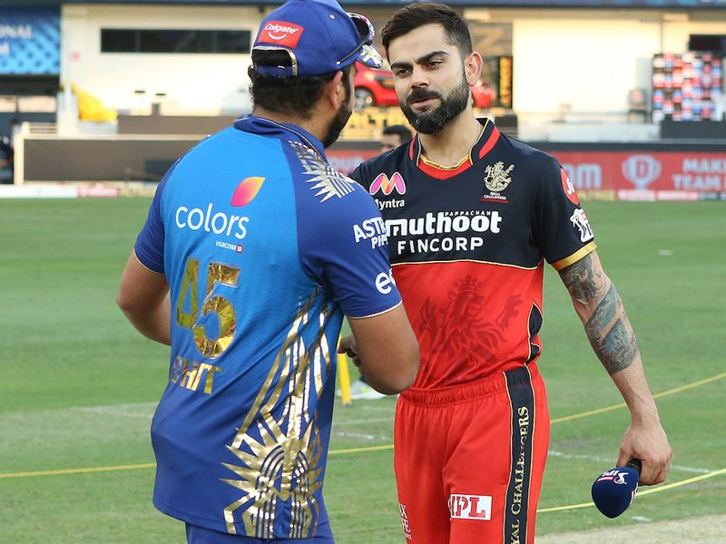 Virat Kohli captain of Royal Challengers Bangalore and Rohit Sharma captain of Mumbai Indians at the toss during match 10 of season 13 of the Dream 11 Indian Premier League (IPL) between The Royal Challengers Bangalore and The Mumbai Indians held at the Dubai International Cricket Stadium, Dubai in the United Arab Emirates on the 28th September 2020. Photo by: Ron Gaunt / Sportzpics for BCCI