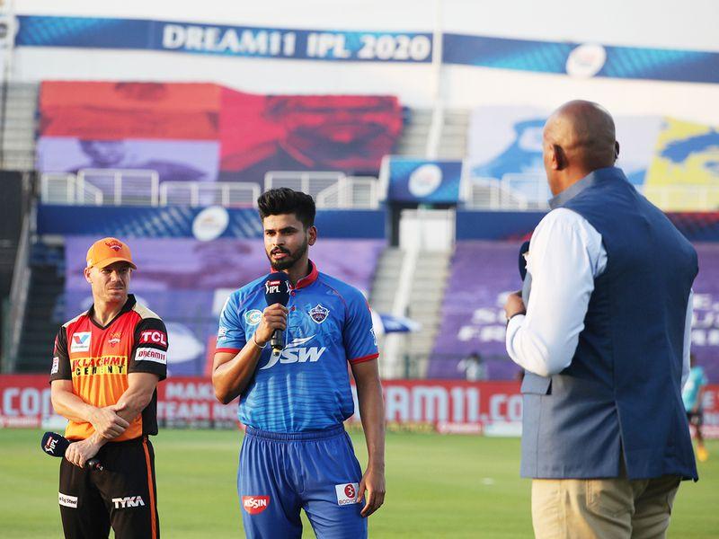 Delhi Capitals' captian Shreyas Iyer (centre) with David Warner (left), captain of Sunrisers Hyderabad during the toss.