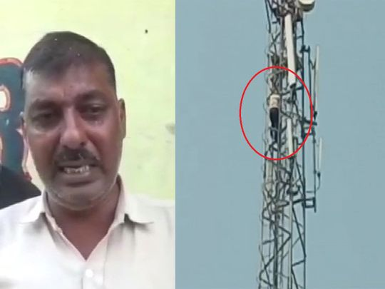 Man climbs up mobile tower