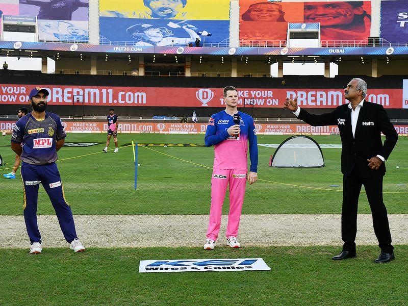 KKR captain Dinesh Karthik (left) and Royals captain Steve Smith are seen during the toss.