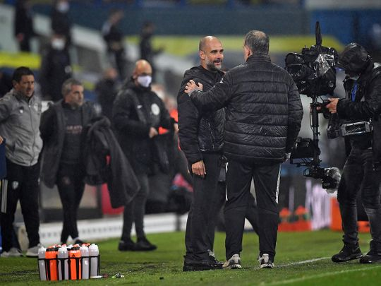 Manchester City's Pep Guardiola with Leeds boss Marcelo Bielsa
