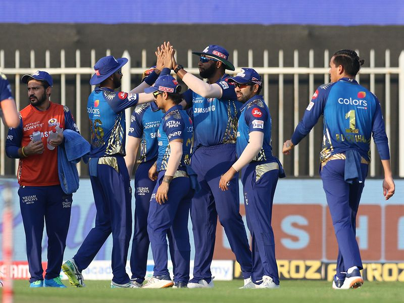 Mumbai Indians players celebrate the wicket of Manish Pandey of Sunrisers Hyderabad.