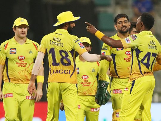 Chennai Superkings players celebrate the wicket of Dinesh Karthik