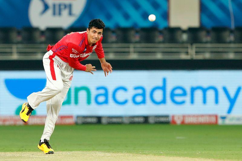 Mujeeb Ur Rahman of Kings XI Punjab bowls during the match.