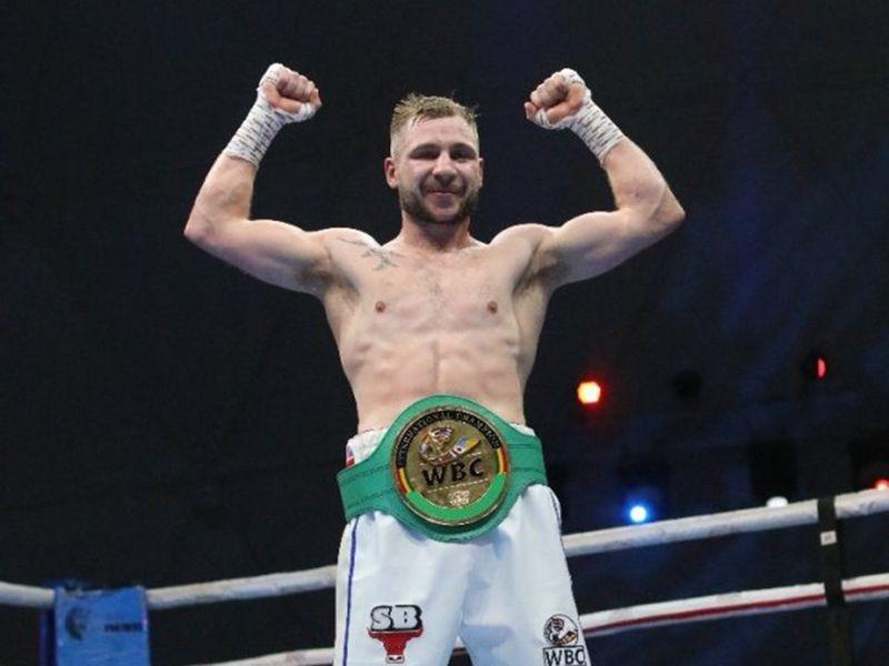 Maxi Hughes with his belt in Dubai