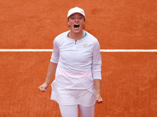 Poland's Iga Swiatek celebrates after winning the French Open final against Sofia Kenin