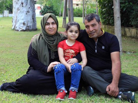Sama with her parents