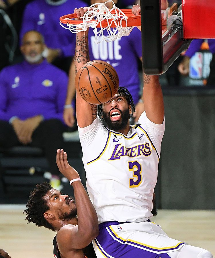 Anthony Davis dunks over  Jimmy Butler  in the first quarter in Game 6 of the NBA Finals on Sunday, Oct. 11, 2020 in Orlando, Florida.