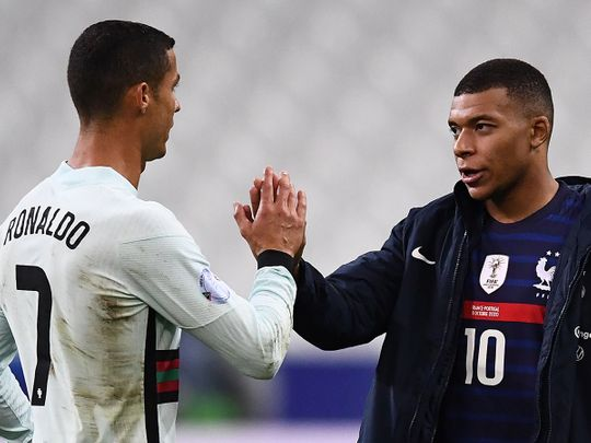Cristiano Ronaldo of Portugal greets France's Kylian Mbappe after the 0-0 draw in Paris