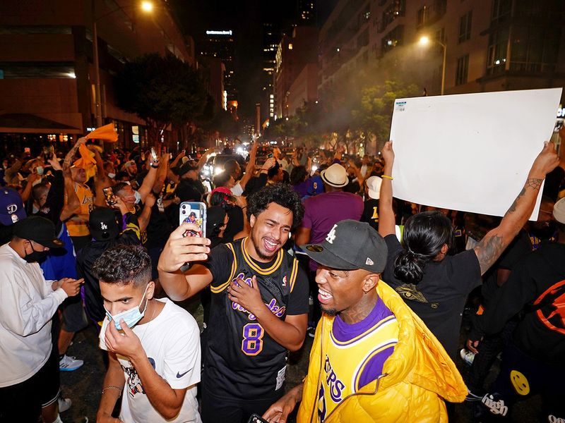Fans celebrate after the Los Angeles Lakers won the 2020 NBA finals
