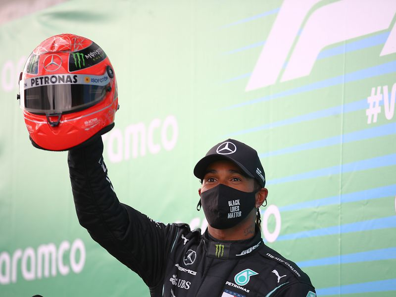Lewis Hamilton with Michael Schumacher's helmet after the Eifel GP in Germany