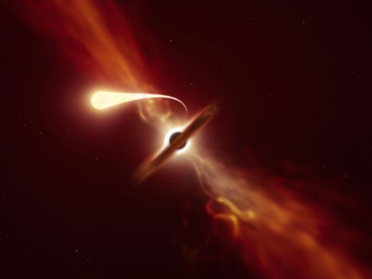 This handout picture released by The European southern Observatory on October 12, 2020, shows an illustration depicting a star (in the foreground) experiencing spaghettification as it's sucked in by a supermassive black hole (in the background) during a