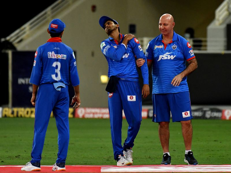 DC Captain Shreyas Iyer in pain after he fell down fielding during match 30 of season 13 of the Dream 11 Indian Premier League (IPL) between the Delhi Capitals and the Rajasthan Royals held at the Dubai International Cricket Stadium, Dubai in the United Arab Emirates on the 14th October 2020. Photo by: Samuel Rajkumar / Sportzpics for BCCI