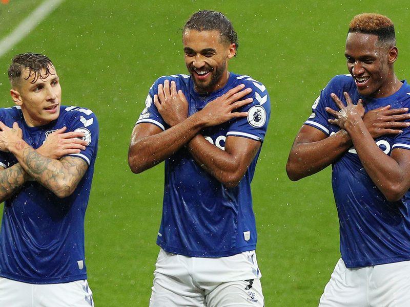 Everton's Yerry Mina celebrates with Lucas Digne and Dominic Calvert-Lewin