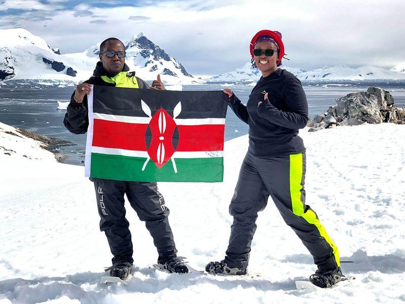 Kariuki and Wamuyu hold the Kenyan flag when in Antarctica.
