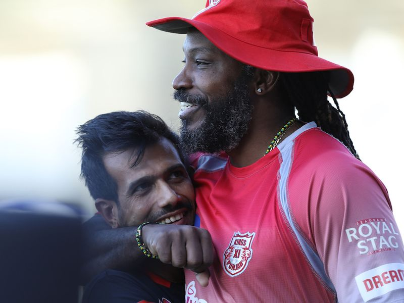 Yuzvendra Chahal of Royal Challengers Bangalore and Chris Gayle of Kings XI Punjab during match 31 of season 13 of the Indian Premier League (IPL ) between the Royal Challengers Bangalore and the Kings XI Punjab held at the Sharjah Cricket Stadium, Sharjah in the United Arab Emirates on the 15th October 2020. Photo by: Arjun Singh / Sportzpics for BCCI