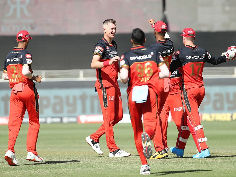 Royal Challengers Bangalore players celebrate the wicket of Ben Stokes of Rajasthan Royals.