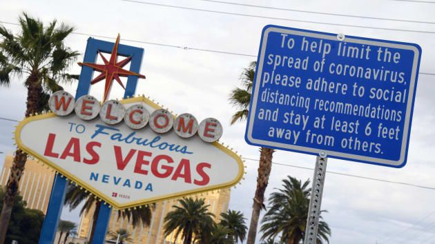 FILE PHOTO: A message on a sign placed in front of the Welcome to Fabulous Las Vegas sign, where tourists often line up to take photos, displays a message about social distancing due to the continuing spread of the coronavirus across the United States on March 22, 2020 in Las Vegas, Nevada.