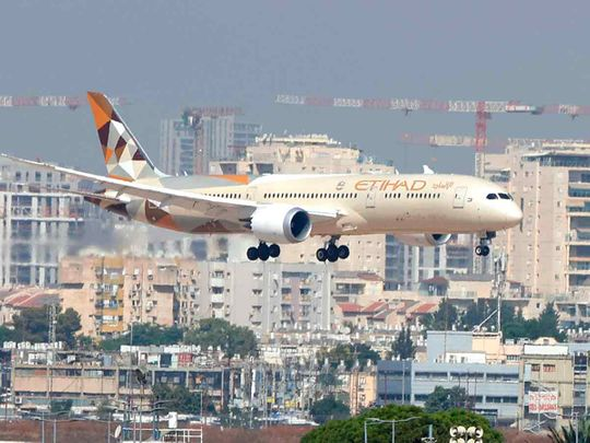 An Etihad Airways plane carrying a delegation from the UAE on a first official visit, lands at Israel's Ben Gurion Airport near Tel Aviv, on October 20, 2020.