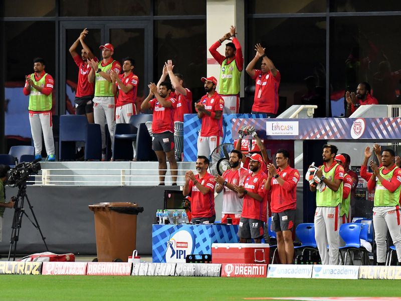 KXIP coaches, captain and team cheer Nicholas Pooran after he hit 50 runs during match 38 of season 13 of the Dream 11 Indian Premier League (IPL) between the Kings XI Punjab and the Delhi Capitals held at the Dubai International Cricket Stadium, Dubai in the United Arab Emirates on the 20th October 2020. Photo by: Samuel Rajkumar / Sportzpics for BCCI