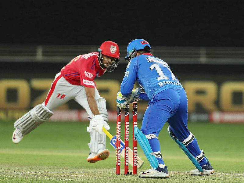 Rishabh Pant of Delhi Capitals runs out Mayank Agarwal of Kings XI Punjab.