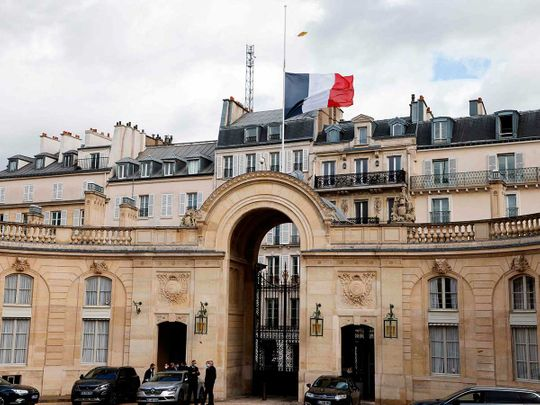 French flag flying at half-mast at the Elysee palace in Paris France
