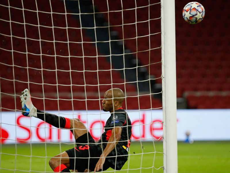 Fabinho clears off the line for Liverpool against Ajax