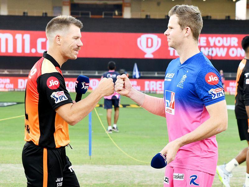 SRH skipper David Warner (left) with RR captain Steven Smith