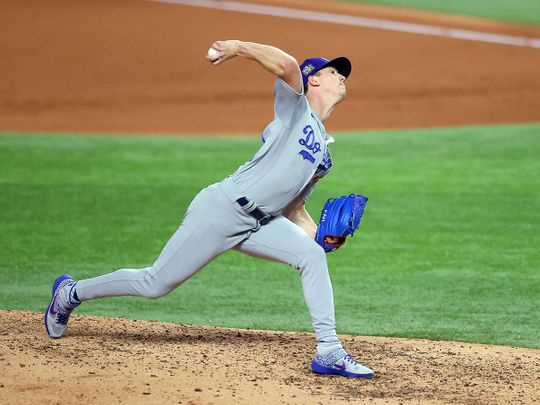 Walker Buehler of the Los Angeles Dodgers delivers against the Tampa Bay Rays during the fifth inning in Game Three of the 2020 MLB World Series at Globe Life Field in Texas