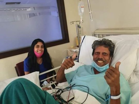 Kapil Dev gives the thumbs up from his hospital bed alongside daughter Amiya.