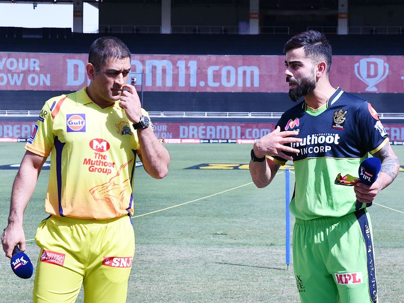 CSK captain MS Dhoni (left) seen with RCB captain Virat Kohli
