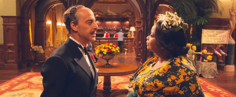 This image released by Warner Bros. Entertainment shows Stanley Tucci, left, and Octavia Spencer in a scene from