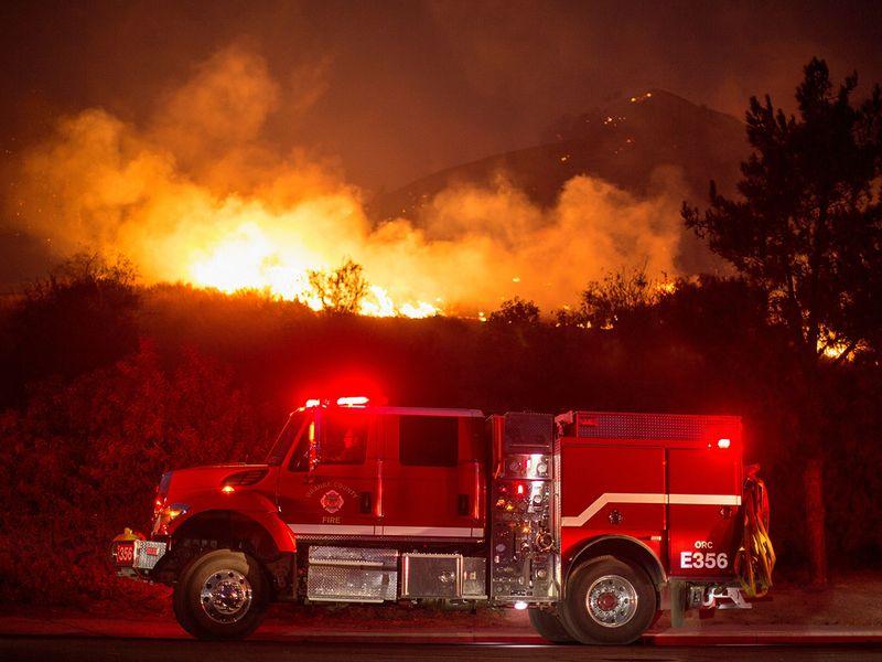 A fire truck is seen near the Blue Ridge Fire burning in Yorba Linda, California.