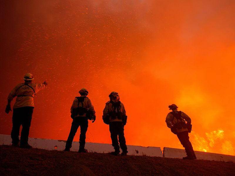 Firefighters watch the Blue Ridge Fire burning in Yorba Linda, California.