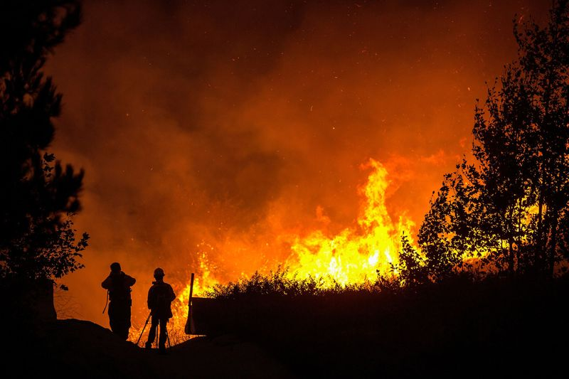 Photographers are silhouetted as they film the Blue Ridge Fire