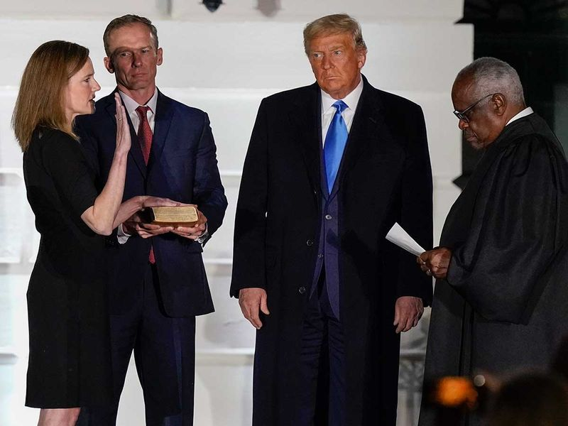 President Donald Trump watches as Supreme Court Justice Clarence Thomas Constitutional Oath to Amy Coney Barrett