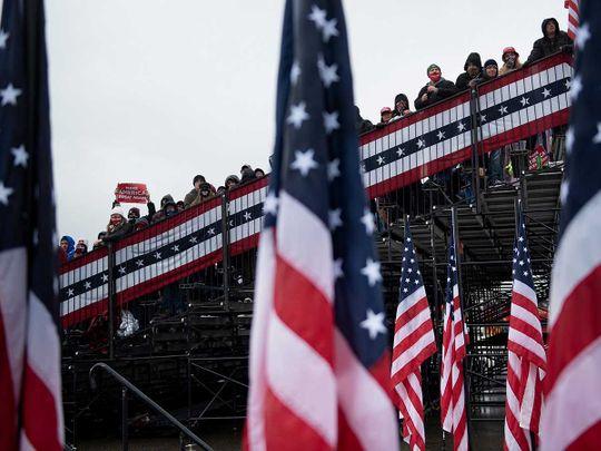 People wait US flag Michigan