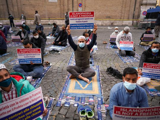 Members of an Italian Muslim association stage a sit-in and prayer to condemn what they see as persecutory acts against the Islamic community in France and against the publication of pictures and what they see as disrespect of the Prophet Muhammad, in Rome, Friday, Oct. 30, 2020. The protesters also condemned the  attack in Nice, France. (AP Photo/Andrew Medichini)Members of an Italian Muslim association stage a sit-in and prayer to condemn what they see as persecutory acts against the Islamic community in France and against the publication of pictures and what they see as disrespect of the Prophet Muhammad, in Rome, Friday, Oct. 30, 2020. The protesters also condemned the  attack in Nice, France.